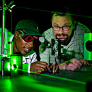 Two Students Studying the Effects of a Green Laser